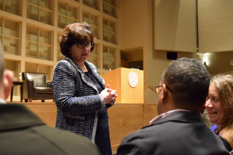 President Martha Pollack chats with audience members before the lecture.