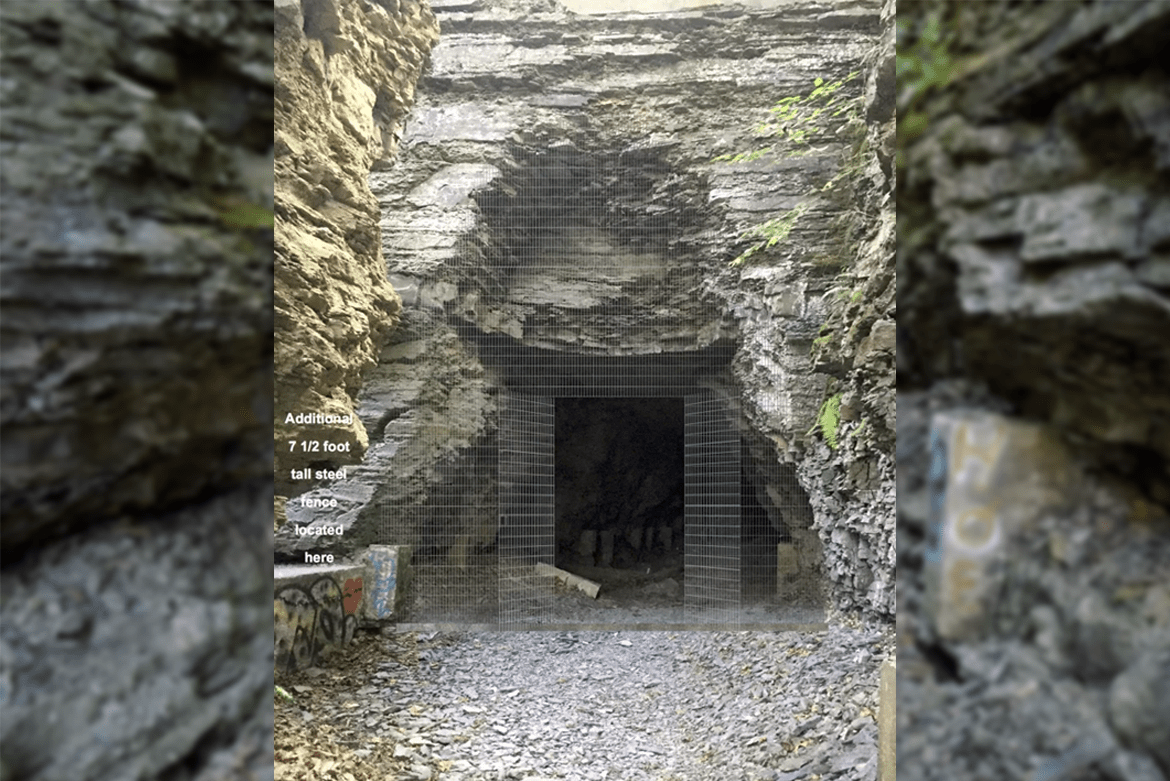 A mock-up of the gate proposed by Cornell in front of Ezra's Tunnel. The 16-foot steel gate will be black, but was made silver in this mock-up to be visible.