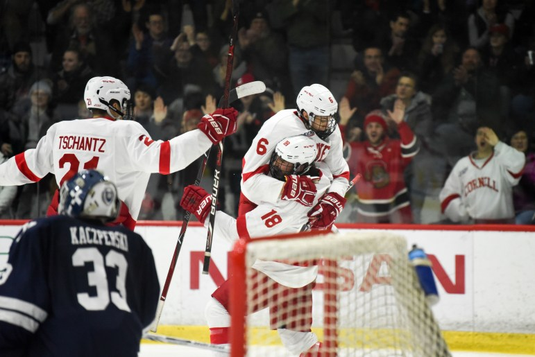 The men's hockey team achieved its first unbeaten slate of Ivy League games since 1996, defeating Yale on Saturday with the aid of well timed goals by freshman Tristan Mullin and senior Jared Fiegl. (Boris Tsang/Sun Staff Photographer)