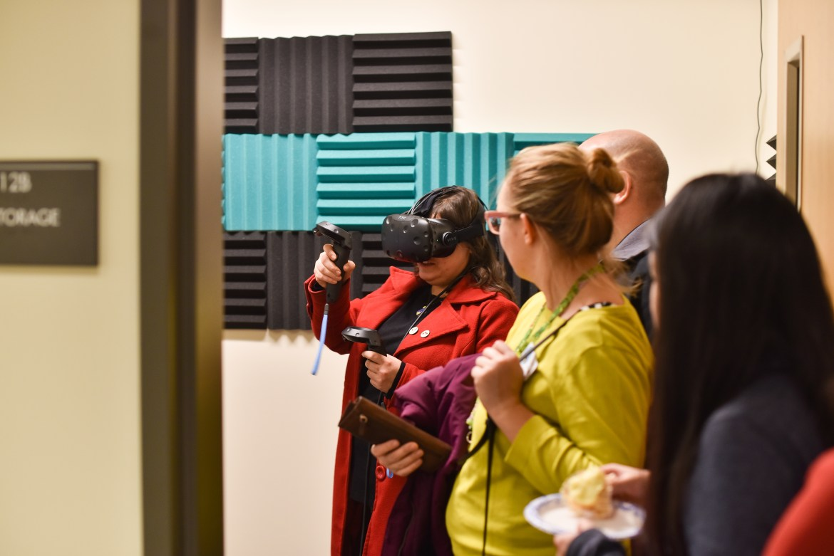 A visitor experiences virtual reality at the opening of MannUfactory on Thursday.
