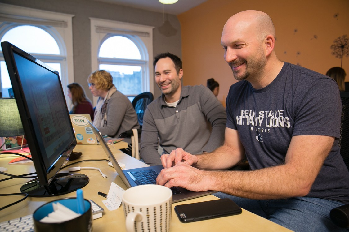 At right, GiveGab CEO Charlie Mulligan, MBA '11, works with chief operating officer Aaron Godert, M.Eng. '05, MBA '11.
