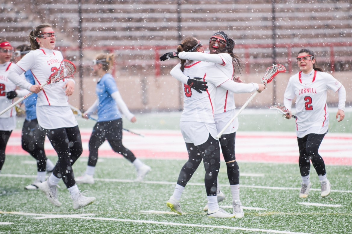 Senior defensive midfielder Joey Coffy celebrates scoring with Senior midfielder Taylor Reed during the Red's match against Columbia on March 10.