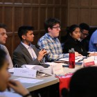 Student Assembly members discuss resolutions about veteran representation and Muslim religious holiday accommodation.