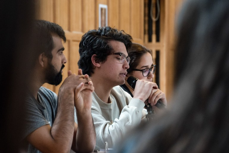 Marco Peralta-Ochoa, Freshmen Representative At-Large, speaks at the Student Assembly meeting on Thursday, during which the SA passed a resolution opposing the potential merger of the School of Industrial and Labor Relations and the College of Human Ecology.