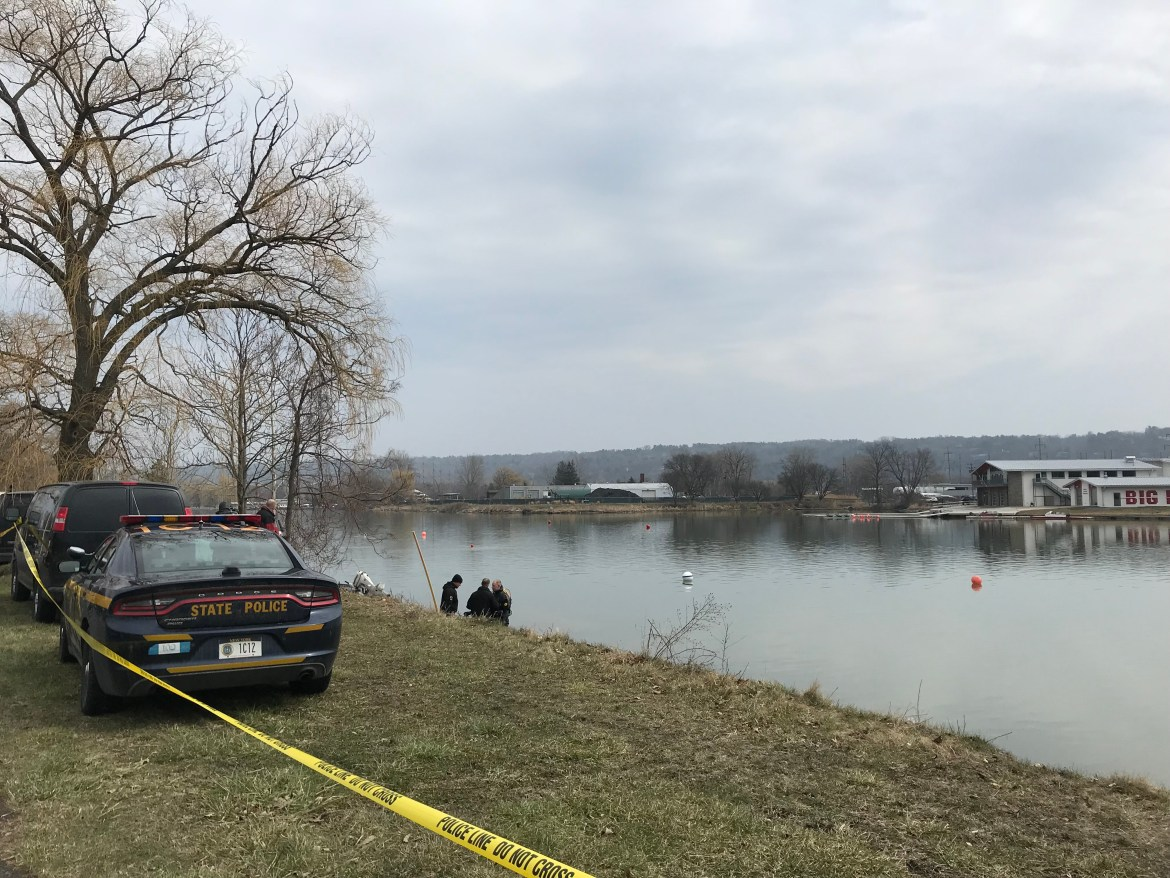New York State Police divers search the Cayuga Inlet in search of a handgun on April 13, 2018.