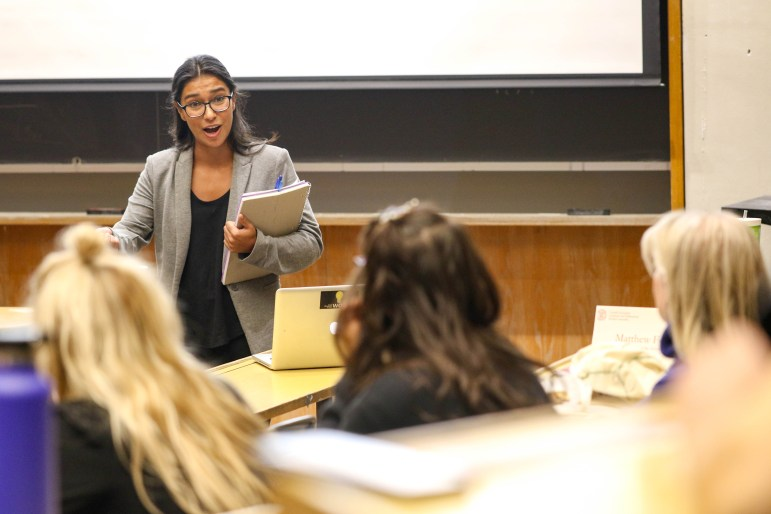 Graduate and professional student trustee candidate Tatiana Padilla speaks at the GPSA meeting on Monday. During the meeting, the three candidates running for the position addressed the University's consensual relationships policy as well as the the need for a more inclusive campus and increased transparency.