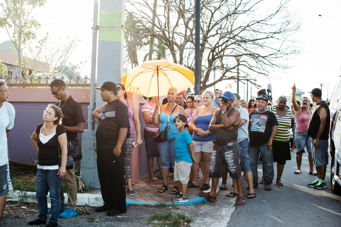 People stand in line for food and water last October in San Isidro, Puerto Rico in the aftermath of Hurricane Maria.