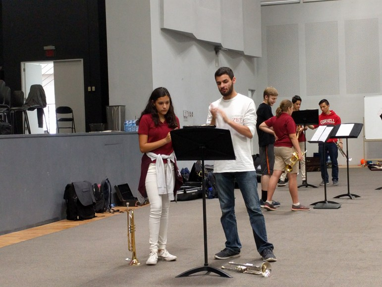 Avram Pinals '18, right, with a Carol Morgan School student during a master class taught by CU Winds members in Santo Domingo, Dominican Republic.