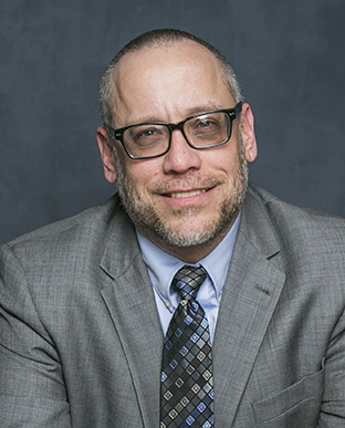 Prof. Todd Schmit