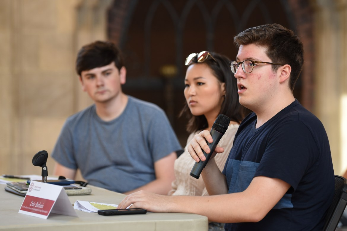 Dale Barbaria '19, S.A. vice president of finance (right) and co-chair of the SAFC Uchral Tergel '19 (center) together explain why the new auditory body is needed.