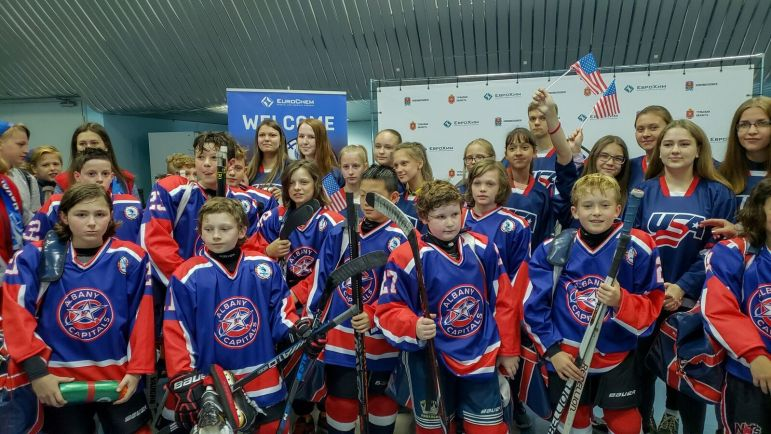 The boys pose for a photo op following a game in Novomoskovsk.
