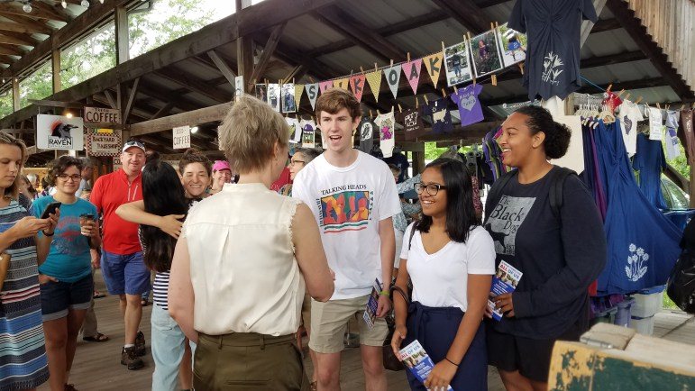 Nixon met with local supporters at the farmers' market, including Cornell juniors Andrew Kohler '20, Shaloni Pinto '20 and Leah Moore '20.
