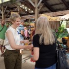 Cynthia Nixon visited the Ithaca Farmers' Market prior to her rally, shaking hands with supporters and sampling local food.