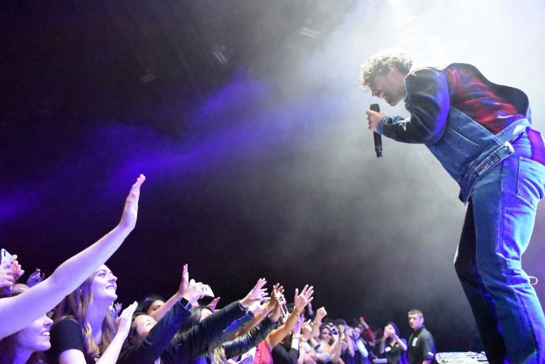 DNCE's vocalist Joe Jonas hypes up the crowd at the Homecoming concert at Barton Hall. (Boris Tsang / Sun Assistant Photography Editor)