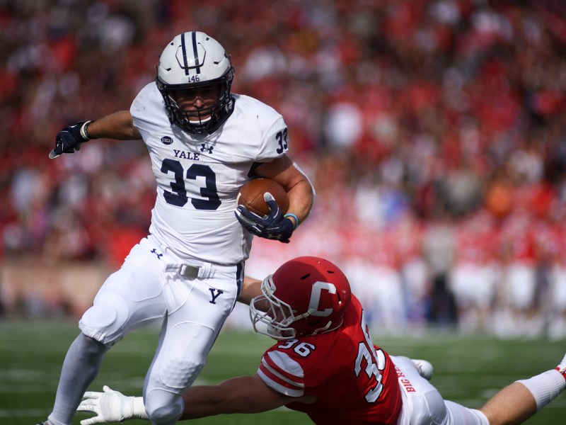 Yale's Zane Dudek, who tormented Cornell last season, attempts one of his 13 rushes on the day. Dudek had only 33 yards Saturday but two touchdowns on a pair rushes five yards or less.