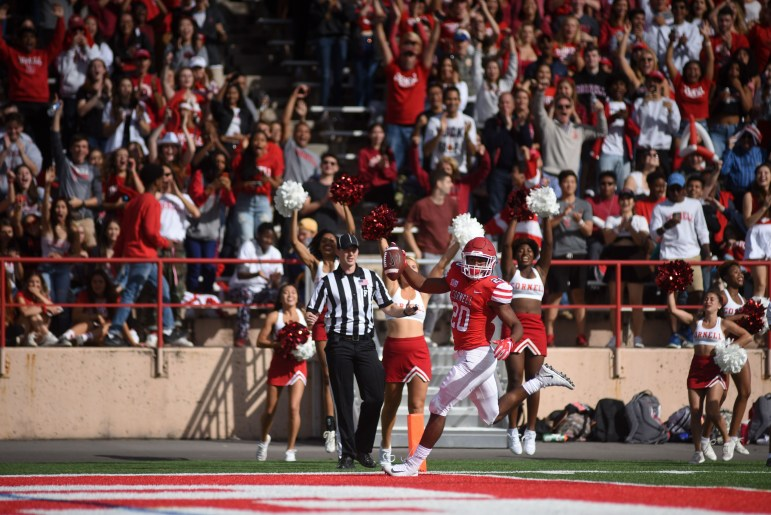 Junior running back Harold Coles celebrates his second touchdown of the day, a 58-yard catch and run. The junior had 130 yards in what was otherwise another lackluster showing for the Cornell offense.