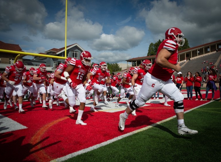 Cornell rushes onto the field in front of 11,400 Homecoming fans.