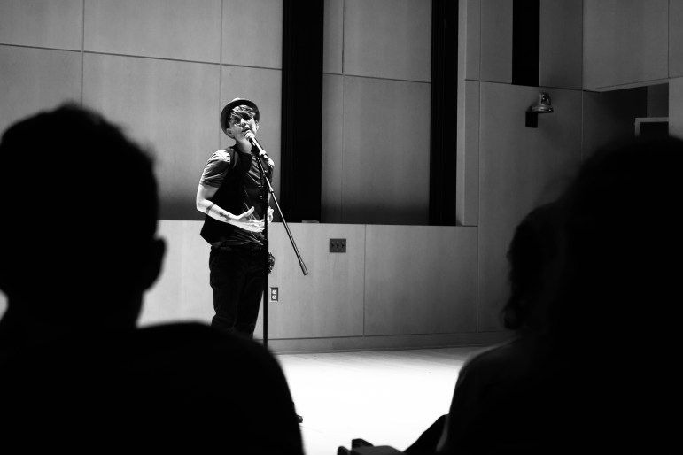 Poet and activitst Andrea Gibson performed at Klarman Hall on Friday. (Jing Jiang / Sun Staff Photographer)