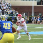 Senior quarterback Dalton Banks attempts a rush in Saturday's loss to Delaware. It was the first showing of Cornell's three-quarterback system.