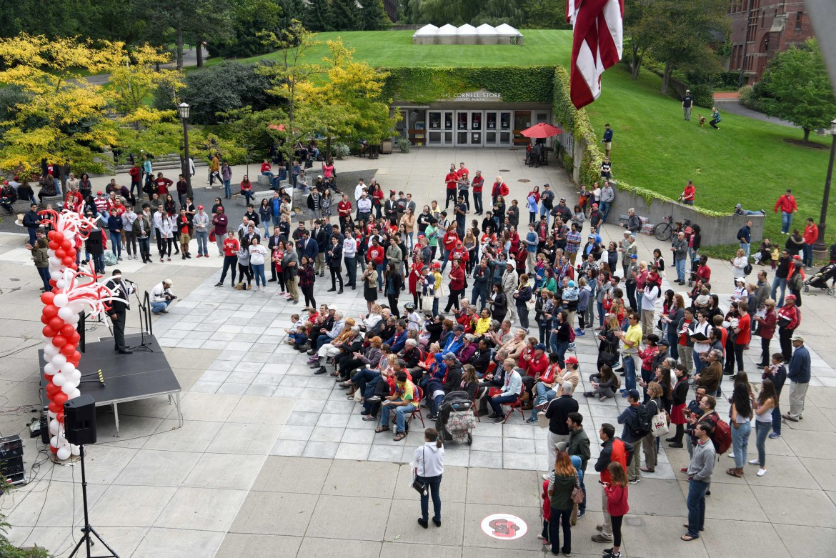 Audience memebers gather in front of Willard Straight Hall to watch the livestream of chimesmasters' performance.
