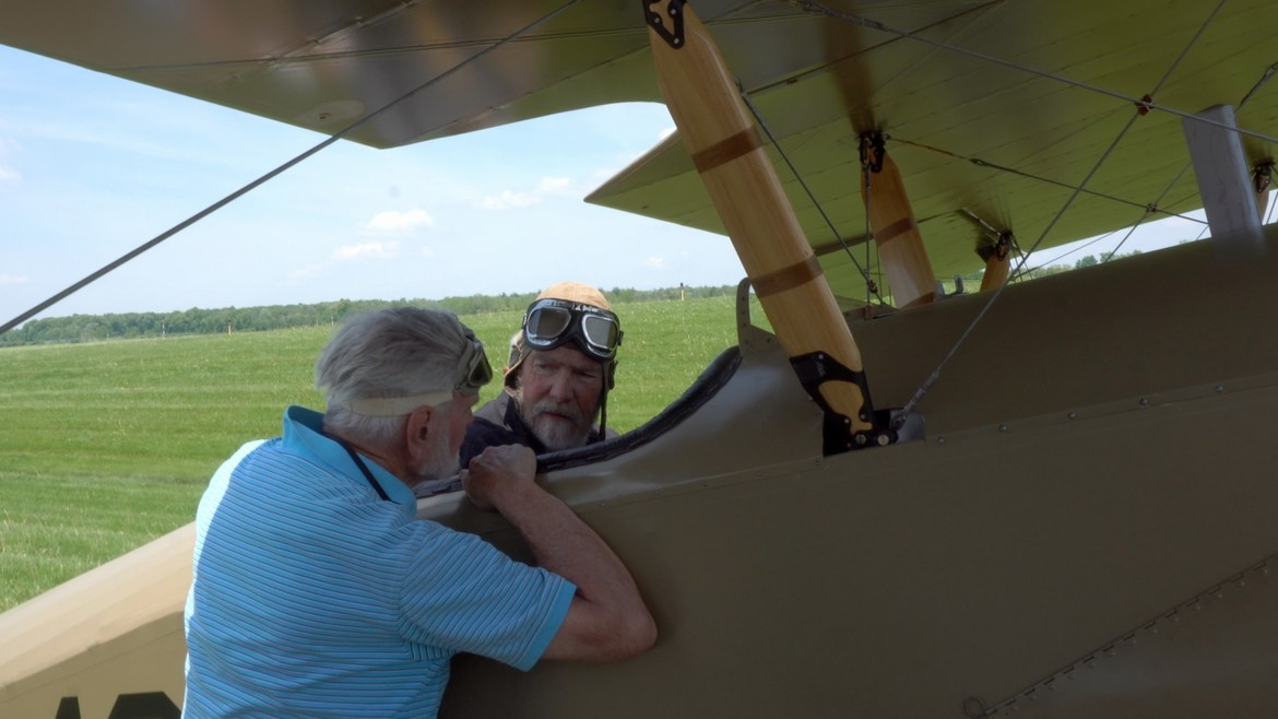 "Ithacans help restore ""Tommy,"" the WW1 biplane, prior to its Sept. 29 flight back to Ithaca."