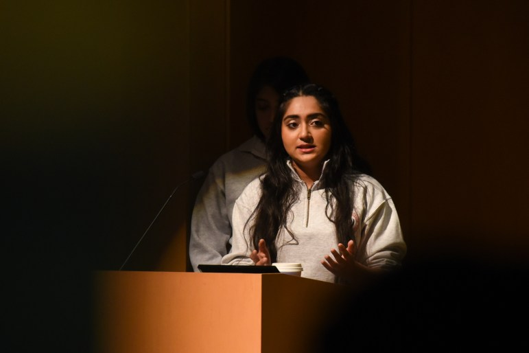 """Sukhmani Kaur '21, president of the Cornell Sikh Students Association, speaks at the the """"Candle Night Gathering for Storytelling and Solidarity"""" event on Wednesday. The gathering gave minority organizations on campus the opportunity to share their stories and the challenges they face through a variety of performances. (Alice Song / Sun Staff Photographer)"""