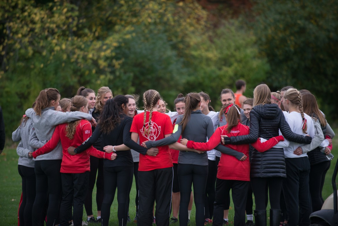 Members of the Women's Cross Country team huddle during the John Reif run in 2016.