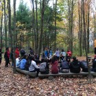Volunteers of Into the Streets 2017 listening to instructions on how to clean the trails of the YMCA'S outdoor education center.