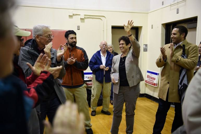 Supporters, including Ithaca Mayor Svante Myrick '09, cheer on Democratic congressional candidate Tracy Mitrano J.D. '95 at a rally on Monday. Although incumbent Rep. Tom Reed (R-N.Y.) stills leads in polls, the margin has decreased in recent weeks, giving Mitrano a better chance at winning than the two previous Democratic challengers. (Boris Tsang / Sun Assistant Photography Editor)