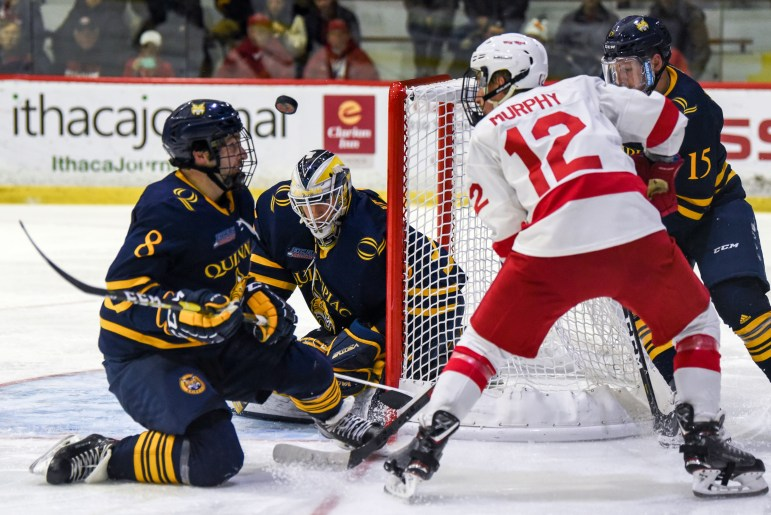 Junior forward Connor Murphy's shot is deflected at the men's hockey game against Quinnipiac on Friday. The Red suffered an unfortunate loss after a crazy bounce off of the glass put the Bobcats up 3-2 in the third period. (Boris Tsang / Sun Assistant Photography Editor)