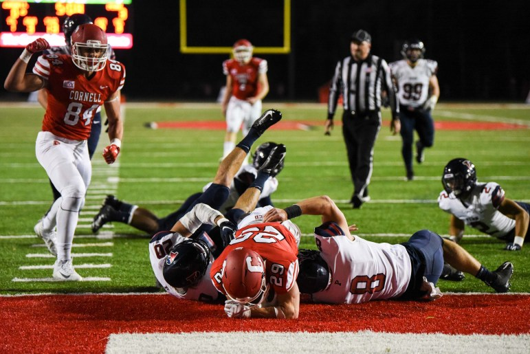 Senior wide receiver Lars Pedersen hauls in a second-quarter touchdown to put Cornell on top. But it was short-lived as Penn won, 20-7.