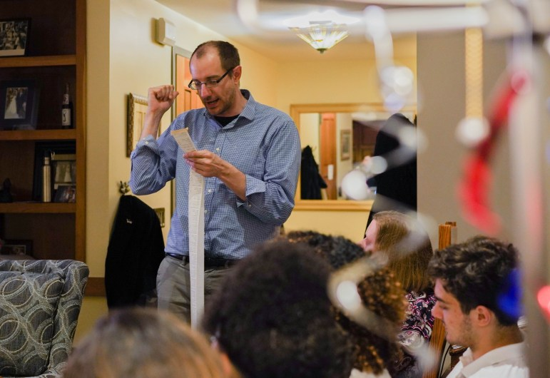 Community members gathered at Prof. Shorna Allred's apartment in Alice Cook House to follow live election results on Tuesday. (Jing Jiang / Sun Staff Photographer)
