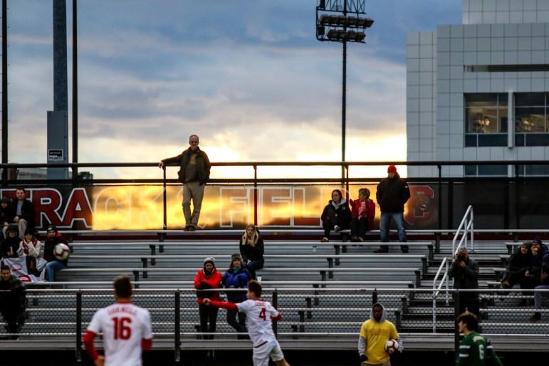 The sun sets over Berman Field as the men's soccer team takes on Dartmouth. (Michael Wenye Li / Sun Photography Editor)