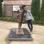 Lyrae Van Clief-Stefanon, associate professor, poses with statue of Sojourner Truth in the city of Esopus, New York. Van Clief-Stefanon wrote a monologue inspired by the activist that was performed in London.