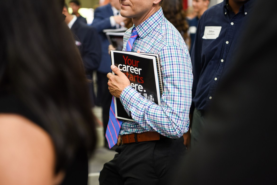 A student clutches materials at this fall's Career Fair, one of the events run each year by Career Services. Recently, Career Services has struggled in coordinating events with employers who go directly to preprofessional fraternities.