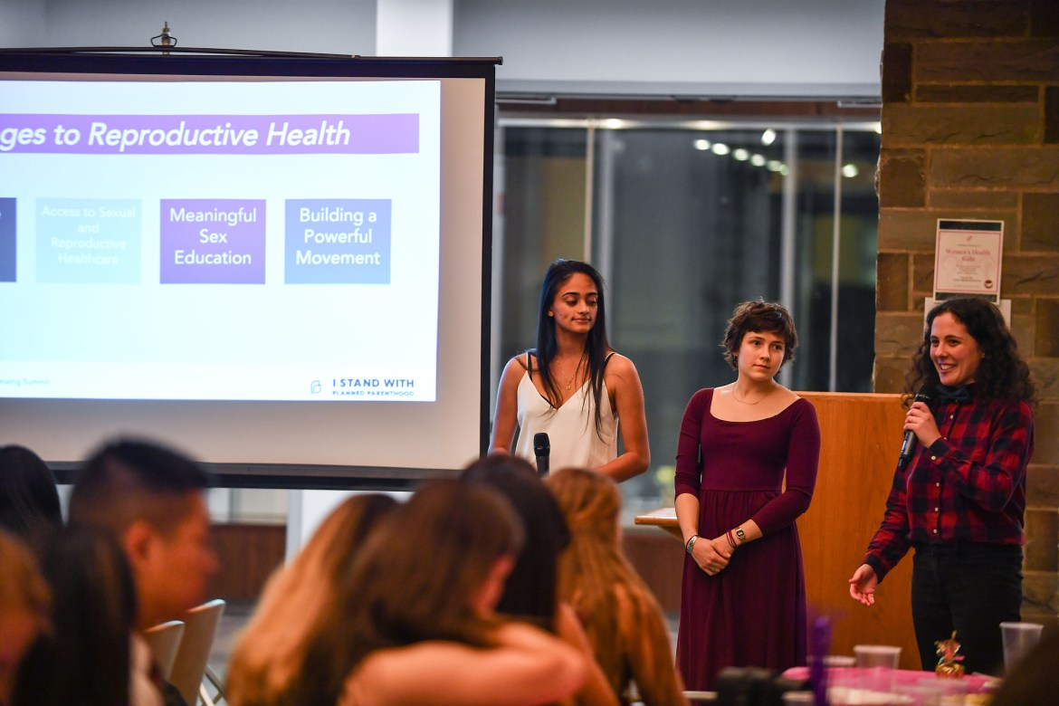 Students in Duffield mingle and eat dinner at GlobeMed's annual fundraising gala focused on women's health and reproductive justice.