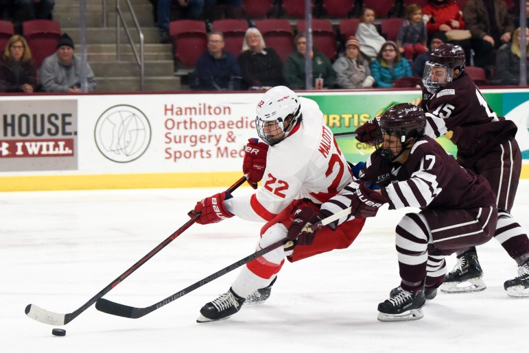 Jeff Malott helped create freshman Michael Regush's game-winning goal at the tail end of a third-period power play.