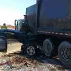 Diesel fluid leaked onto the street after a collision between a passenger vehicle and a garbage truck Thursday morning.