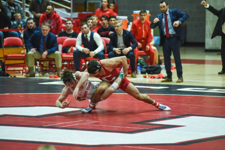 """No. 1 Yianni Diakomihalis scores a takedown on Ohio State's No. 3 Joey McKenna. """"We expect him to win every time he steps on the mat,"""" head coach Rob Koll said."""