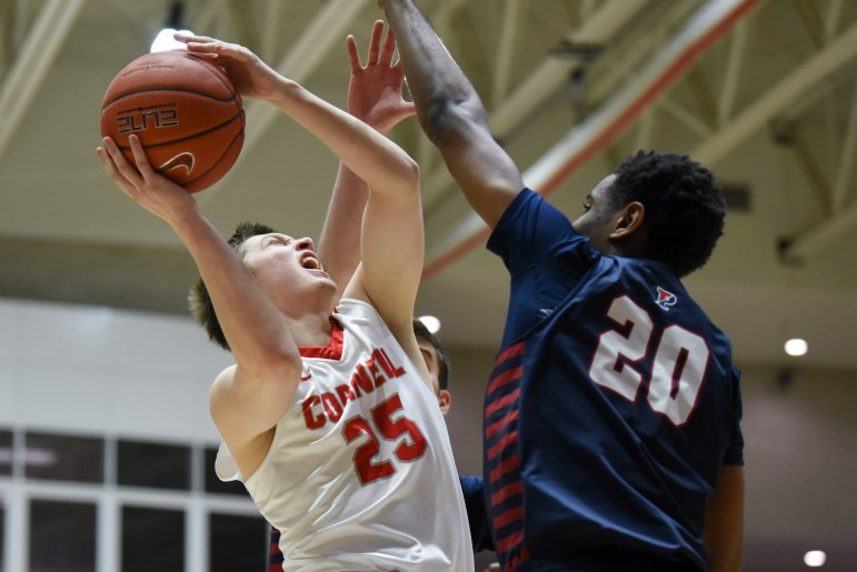 Freshman guard Dean Noll goes up for a layup during the men's basketball team's 80-71 victory over Penn. (Boris Tsang / Sun Assistant Photography Editor)