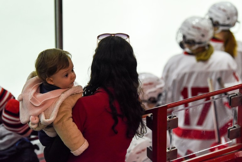 Spectators at the women's hockey game on Saturday. (Boris Tsang / Sun Assistant Photography Editor)