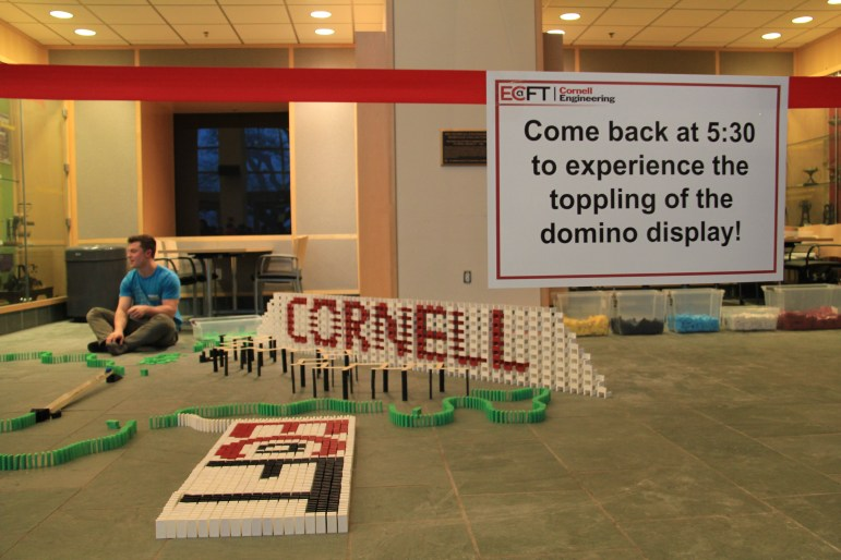 Chris Wright '20 is preparing for his Domino Toppling Show during the Engineering Showcase.