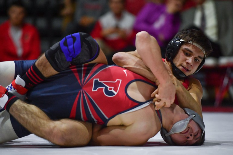 Cornell wrestling claimed a 40-3 victory over Penn on Friday.  (Ben Parker / Sun Staff Photographer)