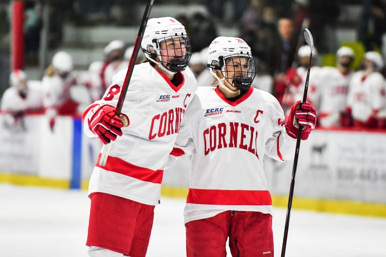 The women's hockey team celebrates after freshman forward Gillis Frechete scored her first career goal against Brown on Friday. The team went on to claim a 4-1 victory. (Ben Parker / Sun Staff Photographer)