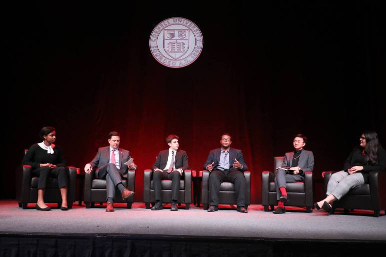 Earlier on Friday, Ryan Lombardi, vice president for student and campus life, second from left, hosted a panel about current Cornell students' stories.
