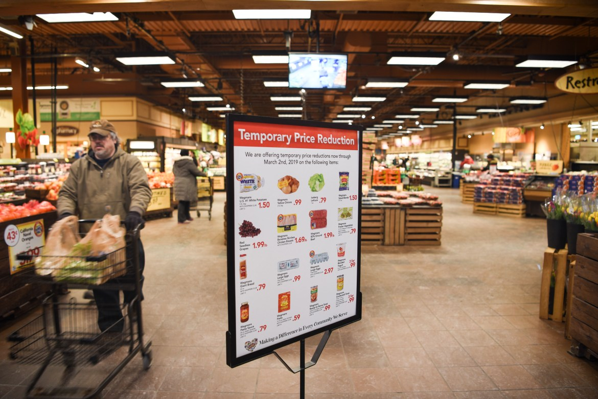 Wegmans displays its temporary price reductions for select food items at the Ithaca store entrance.