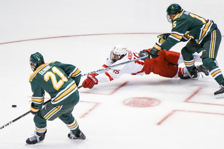 Freshman forward Max Andreev sprawls for a puck in the loss to Clarkson.