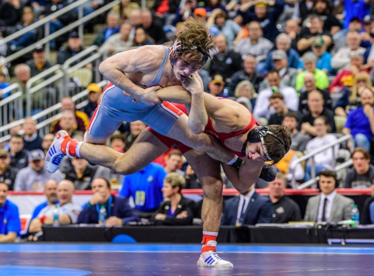 Diakomihalis hits Joey McKenna with a trip to secure his second national title in overtime.