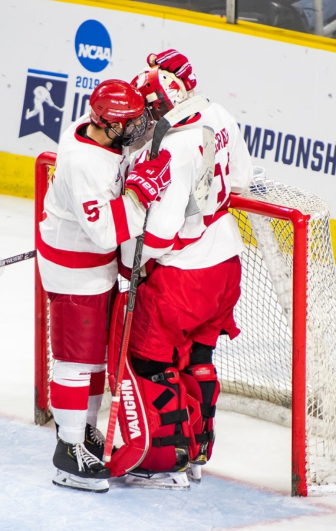 Senior defenseman Matt Nuttle embraces sophomore goalie Austin McGrath after the loss. The latter played with an injury and will undergo surgery next week.