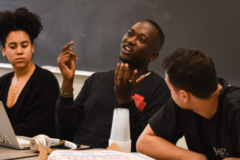 Member of Hip-Hop Heads at Cornell University engage in discussion at their meeting on Friday. (Alice Song / Sun Senior Photographer)